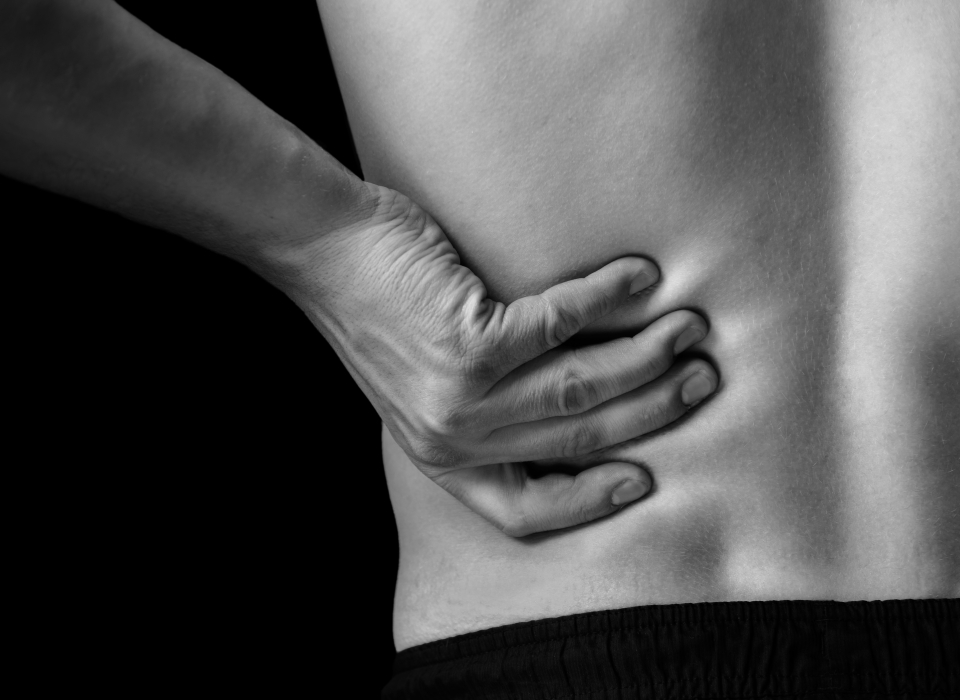 Pain in the lower back, close-up
