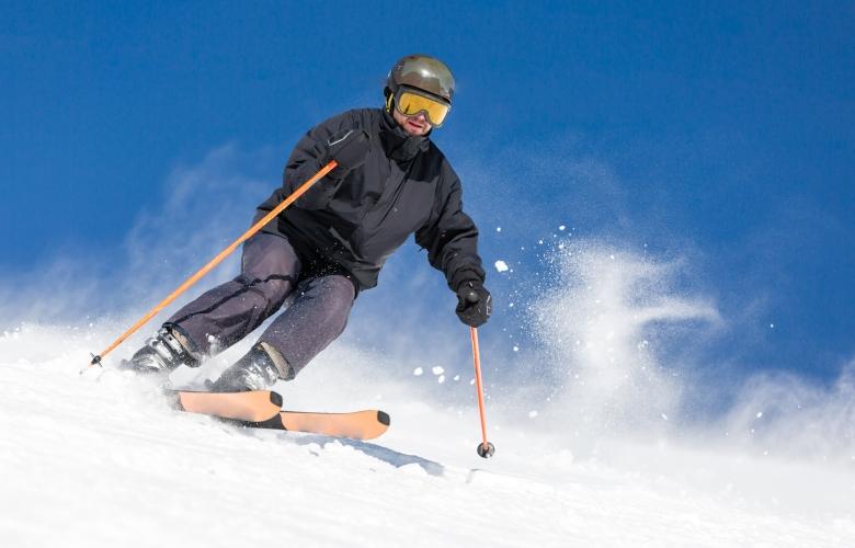 Male skier skiing at ski resort